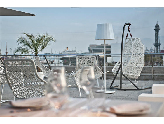 Enjoy a unique perspective on the port of Barcelona and its glamourous yachts - the terrace of 1881.